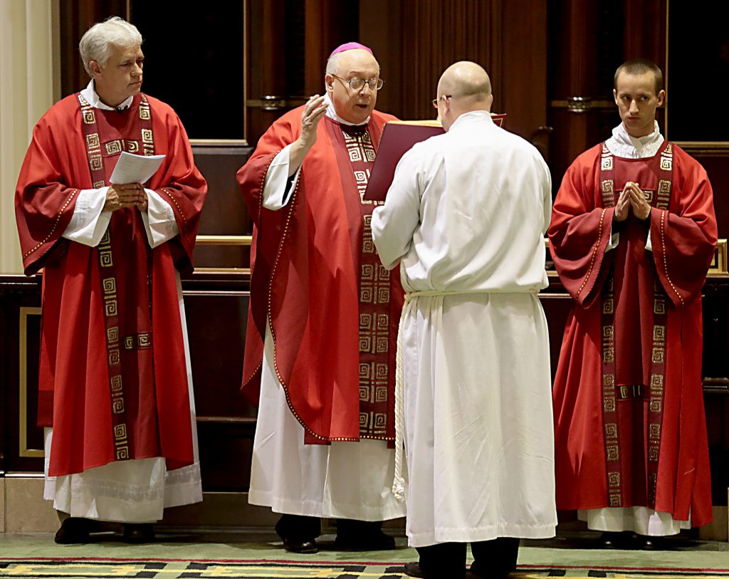 Bishop Joseph Binzer says the Opening Prayer for the Celebration of the Passion of the Lord at the Cathedral of St. Peter in Chains in Cincinnati on Good Friday, Mar. 30, 2018. (CT Photo/E.L. Hubbard)