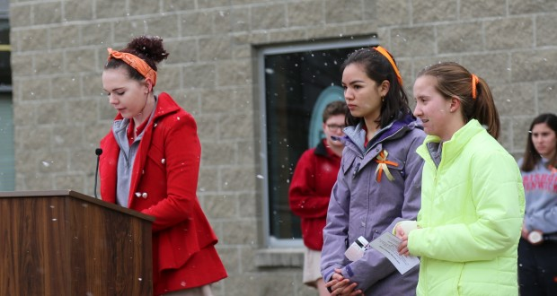 Students pray on National Walkout Day for gun violence victims. (Courtesy Photo)