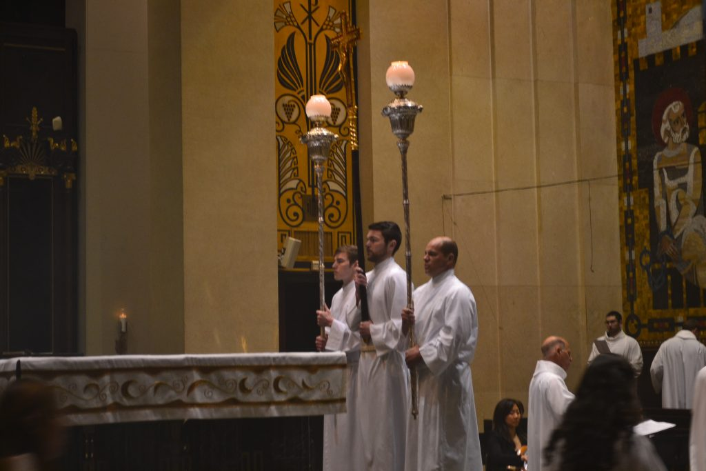 Acolytes during Easter Sunday Mass at the Cathedral. (CT Photo/ Greg Hartman)