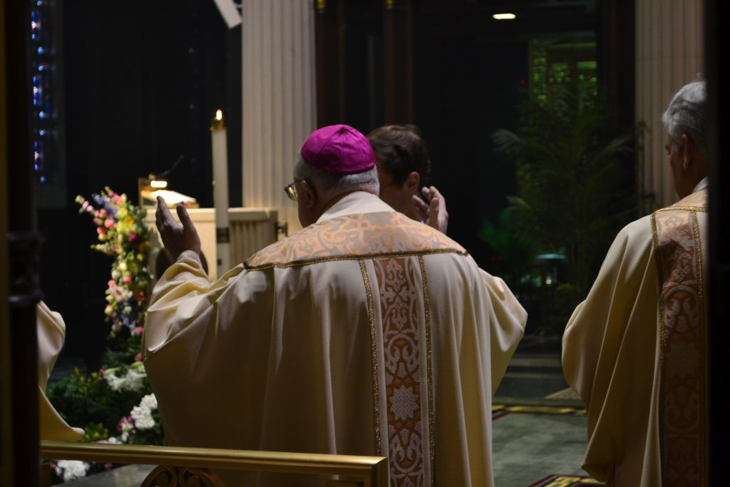 """Bishop Joseph Binzer celebrant: """"O God, who on this day, through your Only Begotton Son, have conquered death and unlocked for us the path to eternity... (CT Photo/Greg Hartman)"""