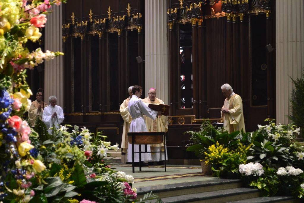 Bishop Joseph Binzer leads the Renewal of Baptismal Promises. (CT Photo/Greg Hartman)