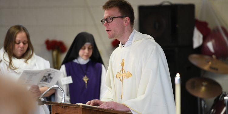 Rev. Ethan Moore proclaims the gospel on Easter Monday at the Dayton Correctional Institution (CT Photo/Mark Bowen)