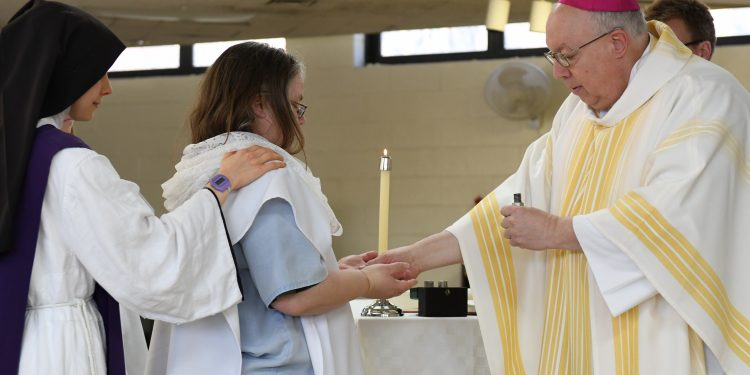 Amie King receives confirmation during Easter Mass. (CT Photo/Mark Bowen)