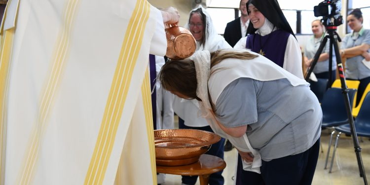 Lee Anna Rayas is baptized into the catholic church during Easter Mass at Dayton Correctional Institution (CT Photo/ Mark Bowen)