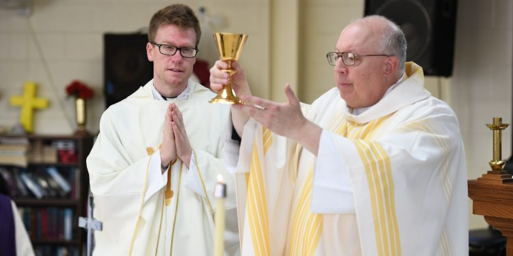 Bishop Binzer and Rev. Ethan Moore during Eucharistic Prayer. (CT Photo/Mark Bowen)