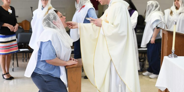 Mincey Meese receives First Communion during Easter Mass. (CT Photo/Mark Bowen)