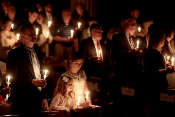 Parishioners hold candles for the Easter Vigil in the Holy Night at the Cathedral of Saint Peter in Chains in Cincinnati, Holy Saturday, March 31, 2018. (CT Photo/E.L. Hubbard)