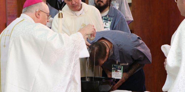 Jonathan Self is baptized during Easter Vigil at Lebanon Correctional Institution (CT Photo/Tom Uhlman)