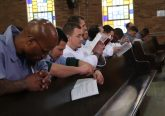 Inmates during the Eucharistic Prayer at Easter Vigil (CT Photo/Tim Uhlman)