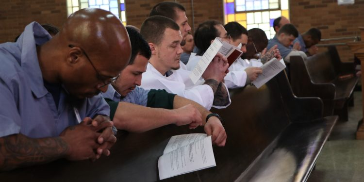 Inmates during the Eucharistic Prayer at Easter Vigil (CT Photo/Tim Uhlman)
