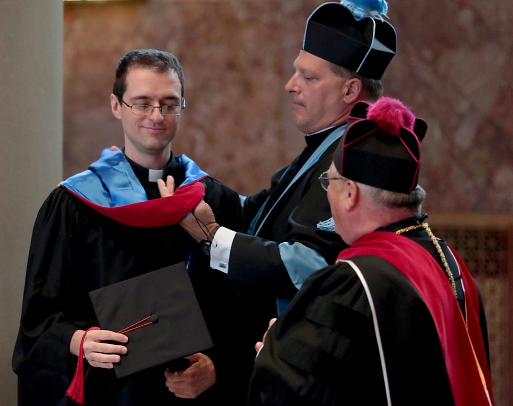 Deacon Andy Smith at the Athenauem of Ohio Graduation (Photo by EL Hubbard)