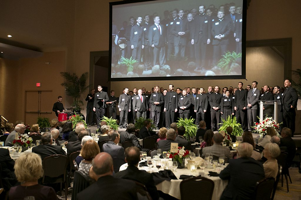 Incoming Rector Father Anthony Brausch, right, and the seminarians of the Athenaeum of Ohio sing an Irish tune for outgoing Rector Father Benedict O'Cinnsealaigh during the Bishop Fenwick Society dinner at the Hilton Cincinnati Netherland Plaza Hotel Friday, May 4, 2018. (CT Photo/ E L Hubbard)