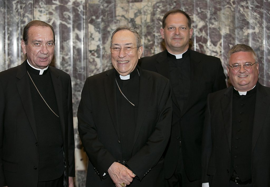 Archbishop Dennis Schnurr, Oscar Cardinal Rodriguez Maradiaga, of Honduras, incoming Rector Father Anthony Brausch, and outgoing Rector Father Benedict O'Cinnsealaigh, at the Bishop Fenwick Society dinner at the Hilton Cincinnati Netherland Plaza Hotel Friday, May 4, 2018. (CT Photo/E L Hubbard)