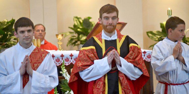 Rev. Jacob Willig awaits the gifts at St. Antoninus Parish (CT Photo/Greg Hartman)