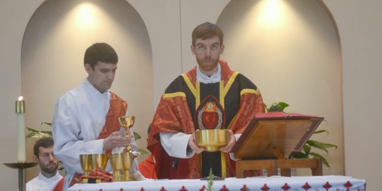 Rev. Jacob Willig prays over the gifts at his First Mass of Thanksgiving. (CT Photo/Greg Hartman)