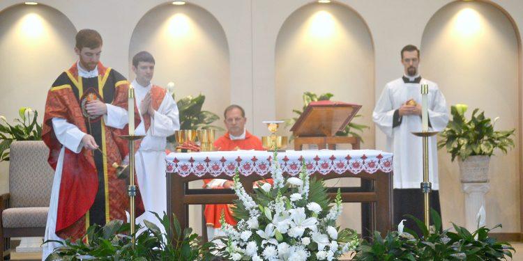 Rev. Jacob Willig censes the altar at St. Antoninus. (CT Photo/Greg Hartman)