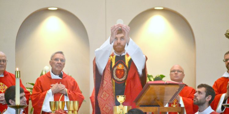 """Rev. Jacob Willig during Eucharistic Prayer I """"...this is my body which will be given up for you."""" (CT Photo/Greg Hartman)"""