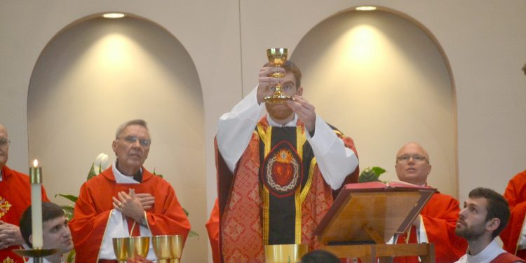 """Rev. Jacob Willig durin Eucharistic Prayer I: """"....and said Take this all of you and drink from it: this is the cup of my blood, the blood of the new and everlasting covenant. It will be shed for you and for all so that sins may be forgiven. Do this in memory of me."""" (CT Photo/Greg Hartman)"""