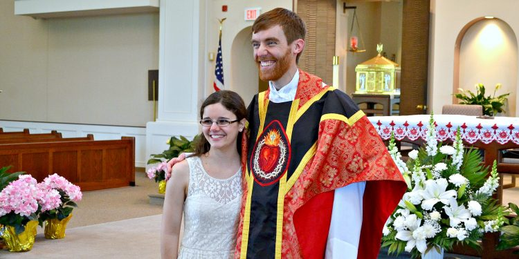 Rev. Jacob Willig poses with his sister (CT Photo/Greg Hartman)