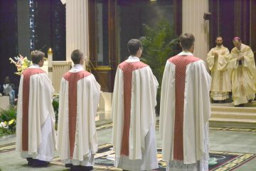 The newly ordained await their assignments (CT Photo/Greg Hartman)