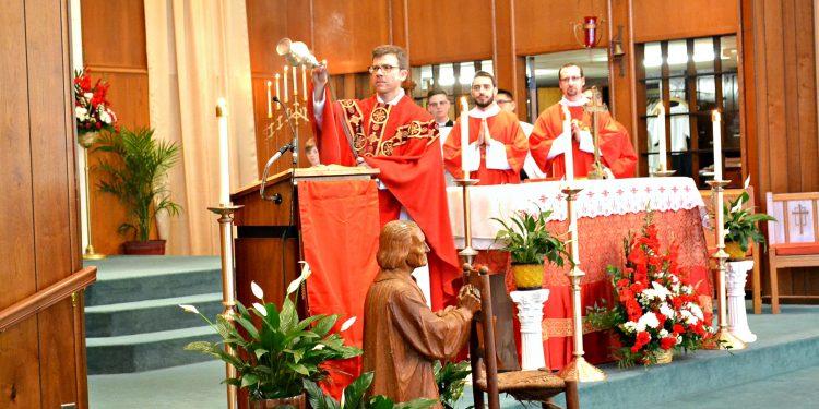 Rev. Craig Best censes the altar at St. Margaret St. John Parish (CT Photo/Greg Hartman)