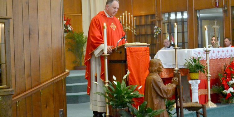 Rev. David Sunberg gives the homily for Rev. Craig Best First Mass of Thanksgiving. (CT Photo/Greg Hartman)