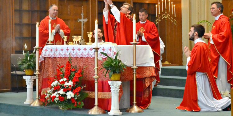 """Rev. Craig Best during the Eucharistic Prayer: """"Take this all of you and eat it...."""" (CT Photo/Greg Hartman"""