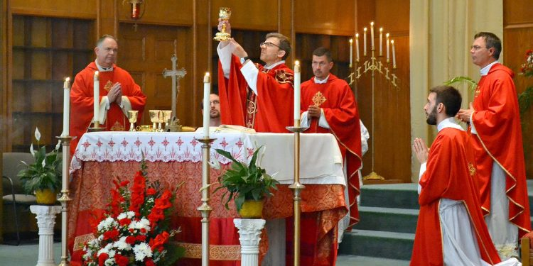 """Rev. Craig Best during Eucharistic Prayer I, """"When supper was ended, he took the cup. Again he gave you thanks and praise, gave the cup to his disciples,..."""" (CT Photo/Greg Hartman)"""