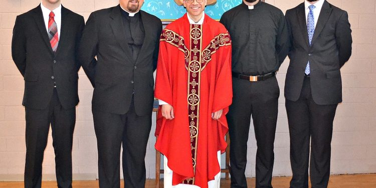 Rev. Craig Best with seminarians that attended his First Mass of Thanksgiving. (CT Photo/Greg Hartman)
