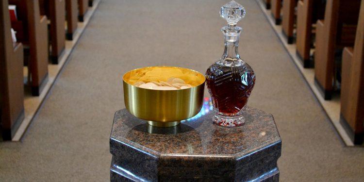 Gifts of bread and wine at St. Antoninus Parish. (CT Photo/Greg Hartman)