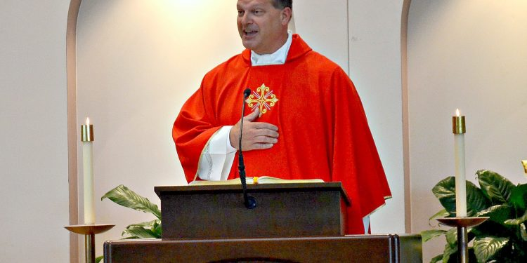Rev. Anthony Brausch gives the homily at Rev. Jacob Willig's First Mass of Thanksgiving. (CT Photo/Greg Hartman)