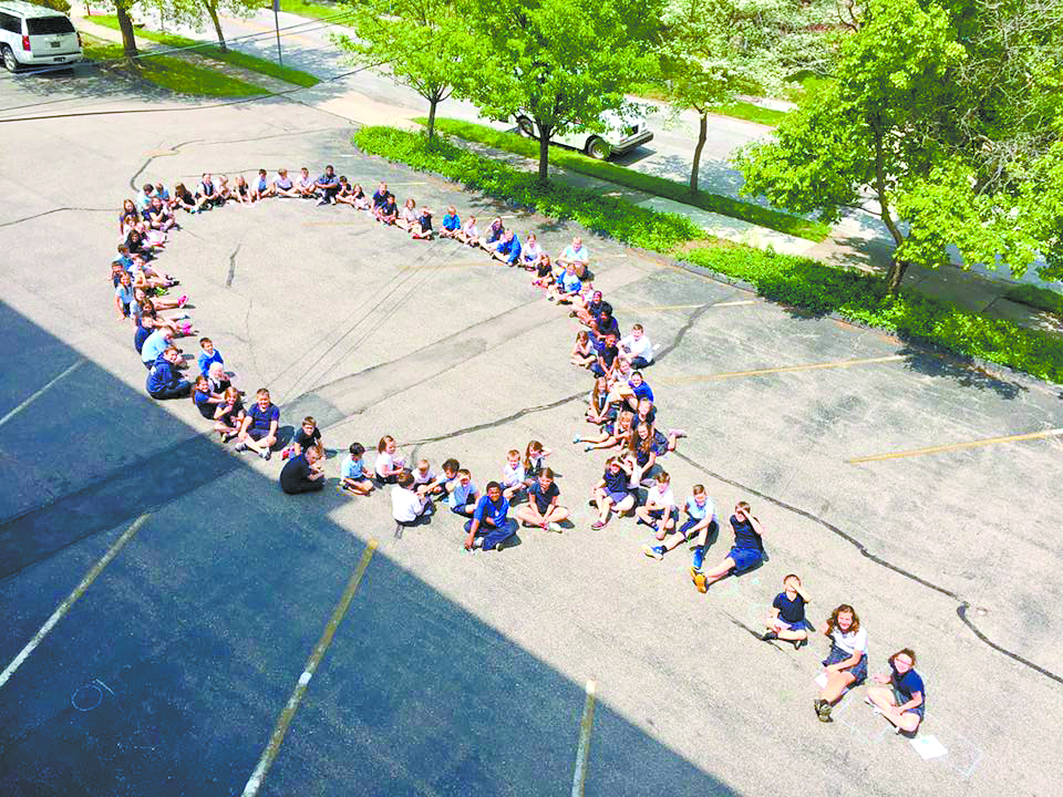 Students at St. Aloysius on-the-Ohio pray a living rosary this past spring. (Courtesy Photo)
