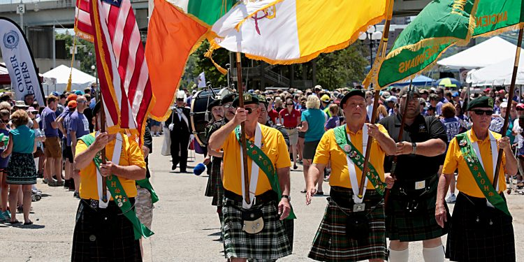 The Ancient Order of Hibernians Color Guard leads the procession during the Cross the Bridge for Life celebration on Riverboat Row in Newport, Sunday, June 3, 2018. (CT Photo/E.L. Hubbard)