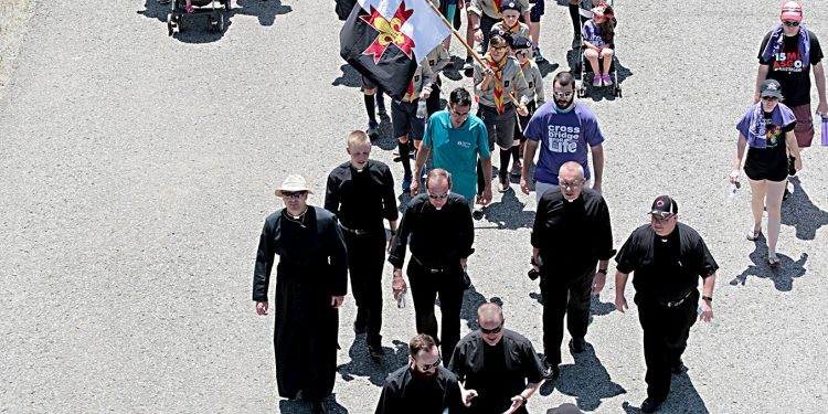Priests from the Diocese of Covington and Archdiocese of Cincinnati walk during the Cross the Bridge for Life celebration on Riverboat Row in Newport, Sunday, June 3, 2018. (CT Photo/E.L. Hubbard)