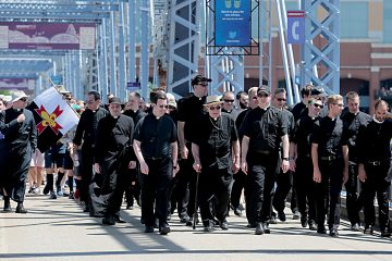 Priests from the Diocese of Covington and Archdiocese of Cincinnati cross the Purple People Bridge during the Cross the Bridge for Life celebration on Riverboat Row in Newport, Sunday, June 3, 2018. (CT Photo/E.L. Hubbard)