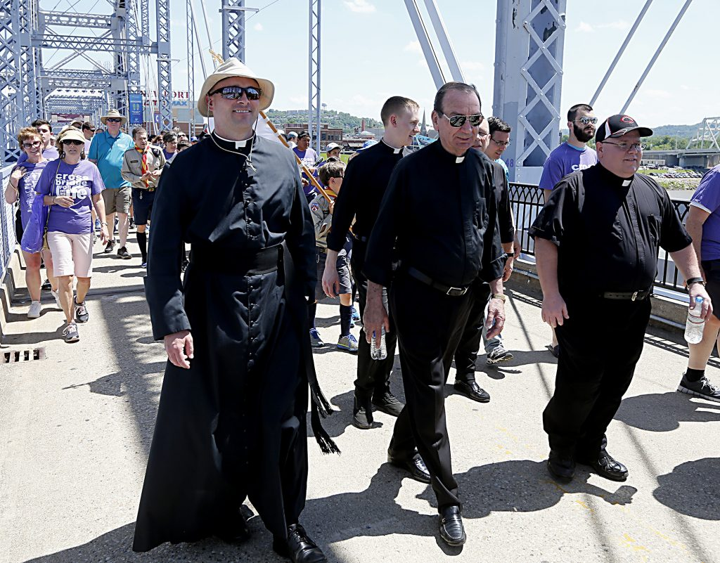 Archbishop Dennis Schnurr, center, crosses the Purple People Bridge with thousands of walkers during the Cross the Bridge for Life celebration on Riverboat Row in Newport, Sunday, June 3, 2018. (CT Photo/E.L. Hubbard)
