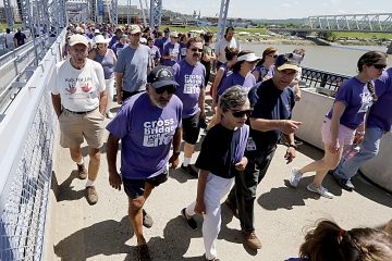 Thousands cross the Purple People Bridge during the Cross the Bridge for Life celebration on Riverboat Row in Newport, Sunday, June 3, 2018. (CT Photo/E.L. Hubbard)