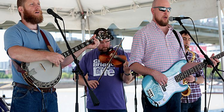 The band Easter Rising plays during the Cross the Bridge for Life celebration on Riverboat Row in Newport, Sunday, June 3, 2018. (CT Photo/E.L. Hubbard)