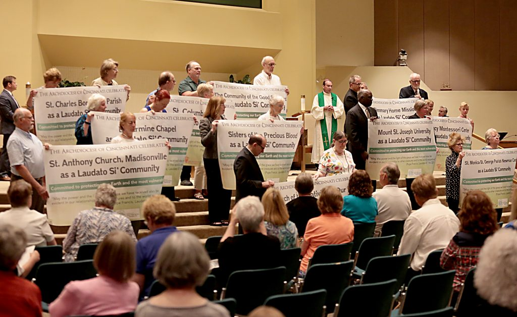 Archbishop Dennis Schnurr, center right, praises the awarded communities during the first annual Laudato Si' Community recognitions ceremony at Good Shepherd Church in Cincinnati Monday, June 18, 2018. (CT Photo/E.L. Hubbard)