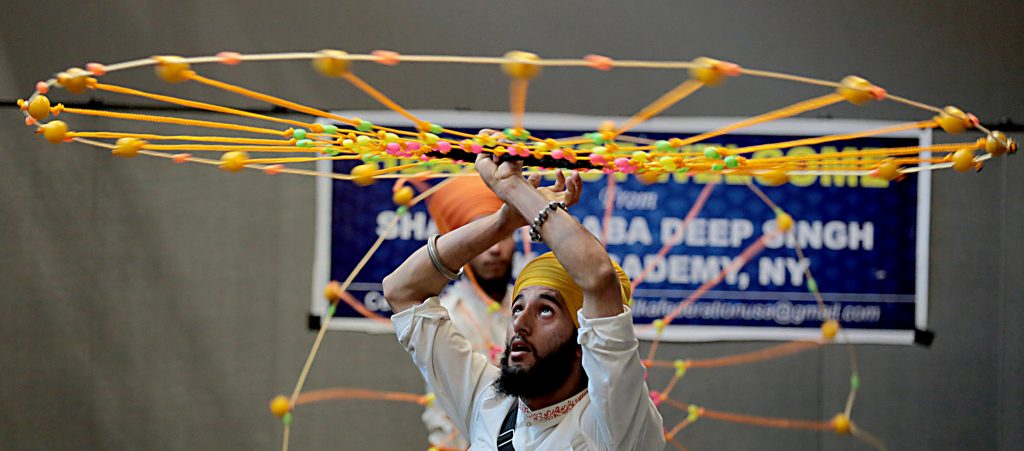 Shaheed Baba Deep Singh GAtka Academy of New York students perform during the first Festival of Faiths at the Cintas Center in Cincinnati Sunday, June 24, 2018. (CT Photo/E.L. Hubbard)
