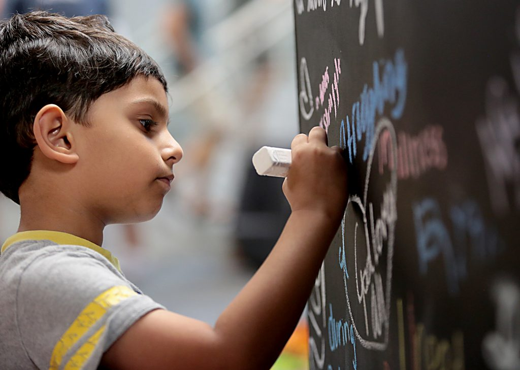 Sahil Furqan, 6, draws his idea of compassion on an art cube during the first Festival of Faiths at the Cintas Center in Cincinnati Sunday, June 24, 2018. (CT Photo/E.L. Hubbard)