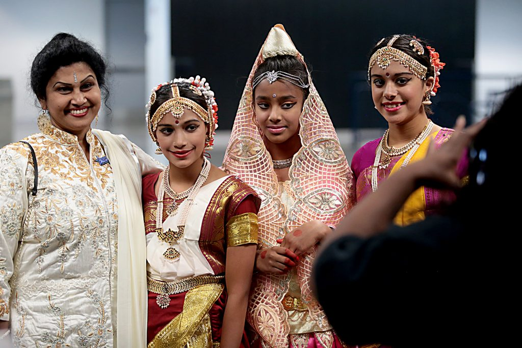 Four Hindu women pose for a snapshot during the first Festival of Faiths at the Cintas Center in Cincinnati Sunday, June 24, 2018. (CT Photo/E.L. Hubbard)