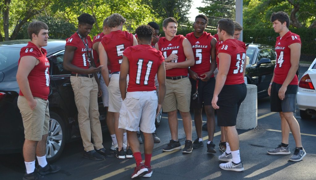 Members of the La Salle Lancer Football team arrive at St. Gertrude for the 2018 Sportsleader Rosary Rally. (CT Photo/Greg Hartman)