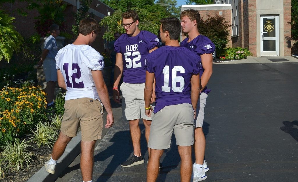 Members of the Elder Panther Football squad gather at St. Gertrude for the 2018 Sportsleader Rosary Rally (CT Photo/Greg Hartman)