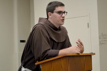 Brother Casey Cole OFM spoke at St. Monica-St. George on July 10. (CT Photo/Greg Hartman)