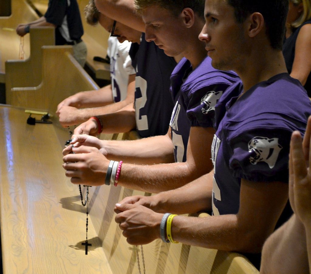 Men from Elder pray the Luminous Mysteries of the Rosary. The Rosary was led by Fr. Anthony Brausch, Rector of Mt. St. Mary's Seminary (CT Photo/Greg Hartman)