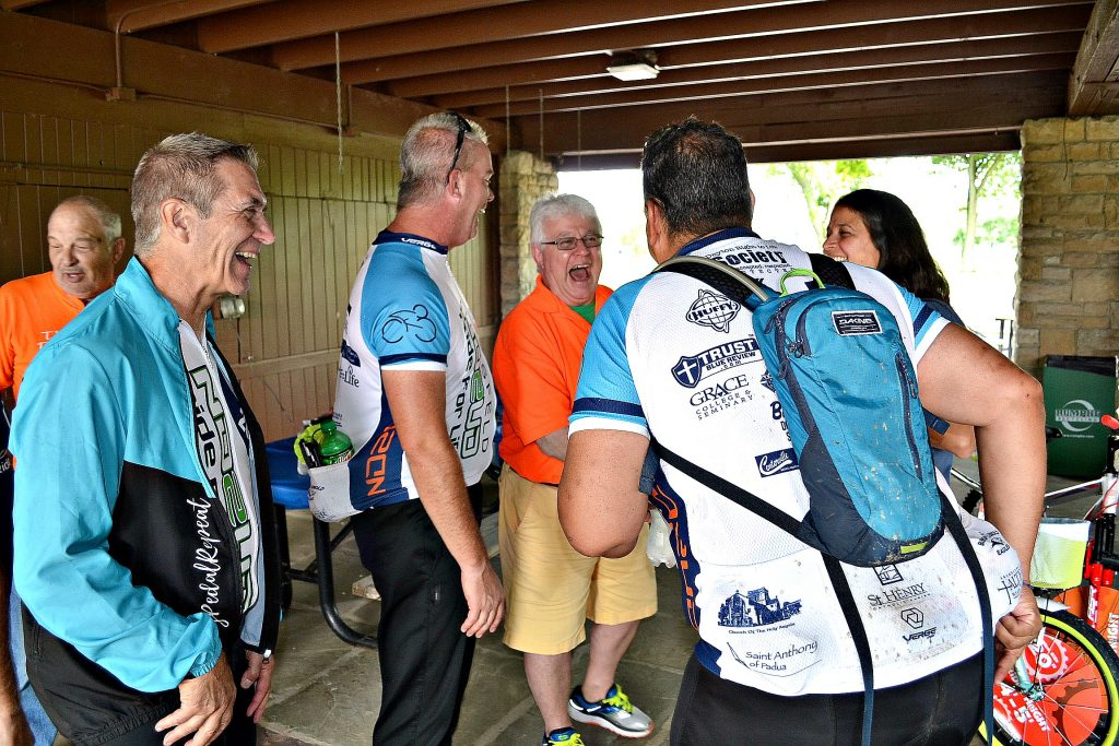 Cyclist just completing their 250 mile ride share stories of the road at the Hausfeld ND2UD Ride for Dayton Right to Life (CT Photo/Greg Hartman)