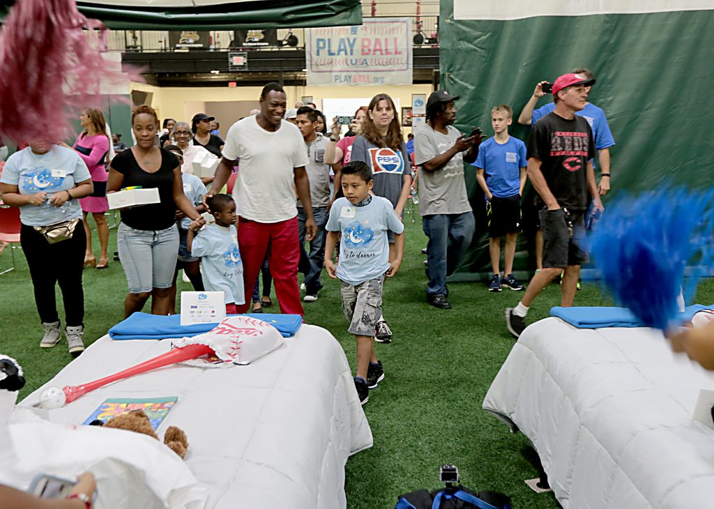 """Children look for their beds during the second annual """"Day to Dream"""" event at the P&G MLB Cincinnati Reds Youth Academy in Roselawn Saturday, Aug. 25, 2018. St. Vincent de Paul - Cincinnati and Morris Furniture Company teamed up to provide 50 children in need with a bed of their own. (CT Photo/E.L. Hubbard)"""