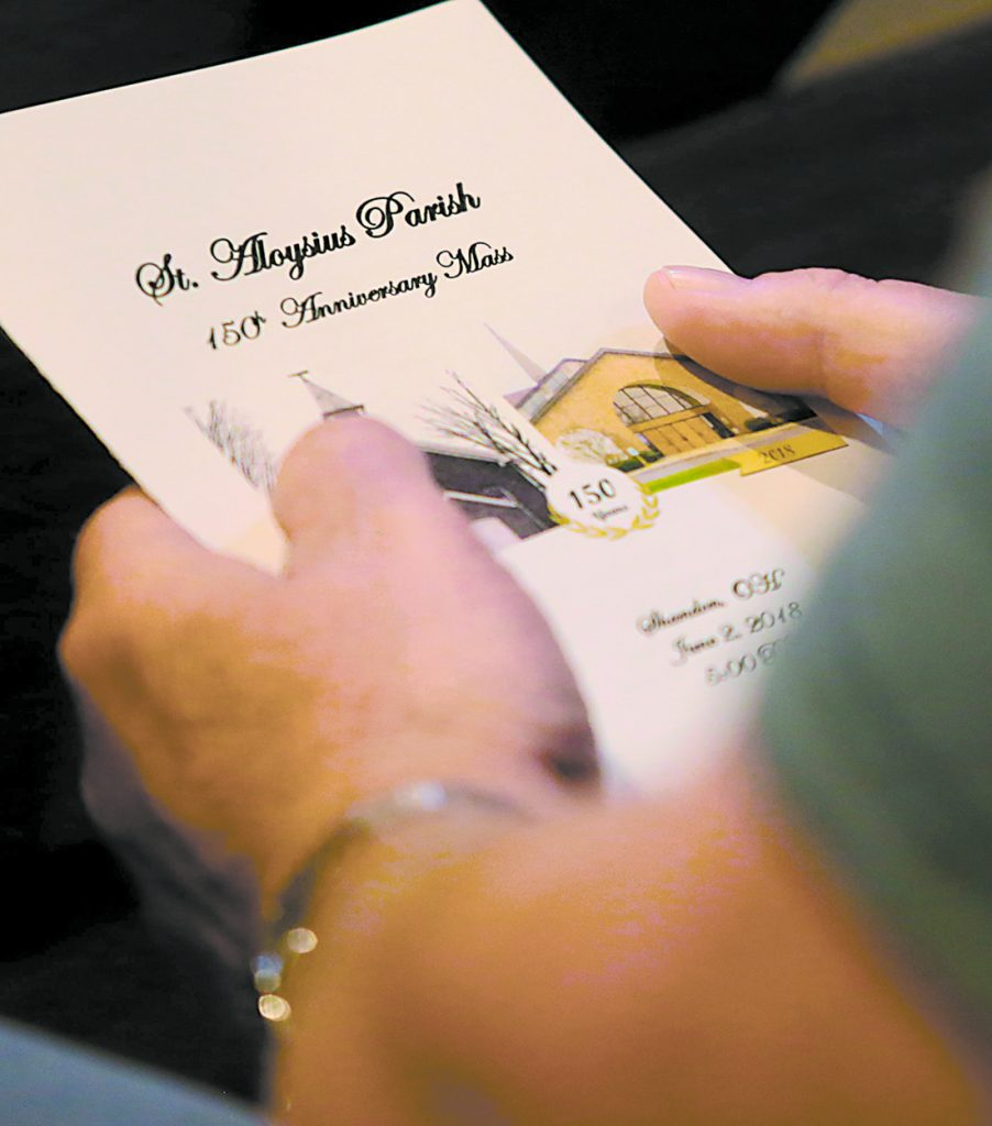 A parishioner holds a program for the St. Aloysius Parish 150th Anniversary Mass in Shandon Saturday, June 2, 2018. (CT Photo/E.L. Hubbard)