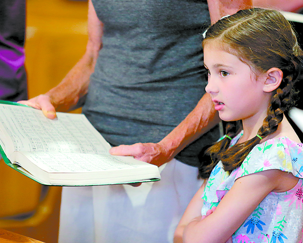 Paisley Wanamaker, 5, sings during the St. Aloysius Parish 150th Anniversary Mass in Shandon Saturday, June 2, 2018. (CT Photo/E.L. Hubbard)